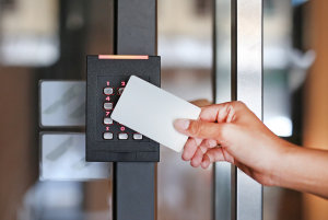 Woman Using Key Card To Activate Commercial Access Control Sytem | Pompano Beach FL Commercial Locksmith